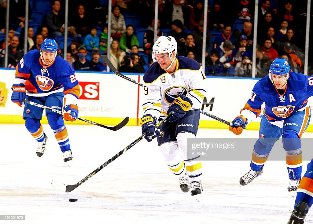 Steve Ott #9 of the Buffalo Sabres skates with the puck against the New York Islanders during their game at Nassau Veterans Memorial Coliseum on February 9, 2013 in Uniondale, New York.