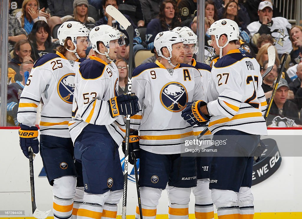 <a gi-track='captionPersonalityLinkClicked' href=/galleries/search?phrase=Steve+Ott&family=editorial&specificpeople=210616 ng-click='$event.stopPropagation()'>Steve Ott</a> #9 of the Buffalo Sabres talks with <a gi-track='captionPersonalityLinkClicked' href=/galleries/search?phrase=Adam+Pardy&family=editorial&specificpeople=2221762 ng-click='$event.stopPropagation()'>Adam Pardy</a> #27, <a gi-track='captionPersonalityLinkClicked' href=/galleries/search?phrase=Mark+Pysyk&family=editorial&specificpeople=6571526 ng-click='$event.stopPropagation()'>Mark Pysyk</a> #53 and <a gi-track='captionPersonalityLinkClicked' href=/galleries/search?phrase=Mikhail+Grigorenko&family=editorial&specificpeople=8771251 ng-click='$event.stopPropagation()'>Mikhail Grigorenko</a> #25 during the third period against the Pittsburgh Penguins on April 23, 2013 at Consol Energy Center in Pittsburgh, Pennsylvania.
