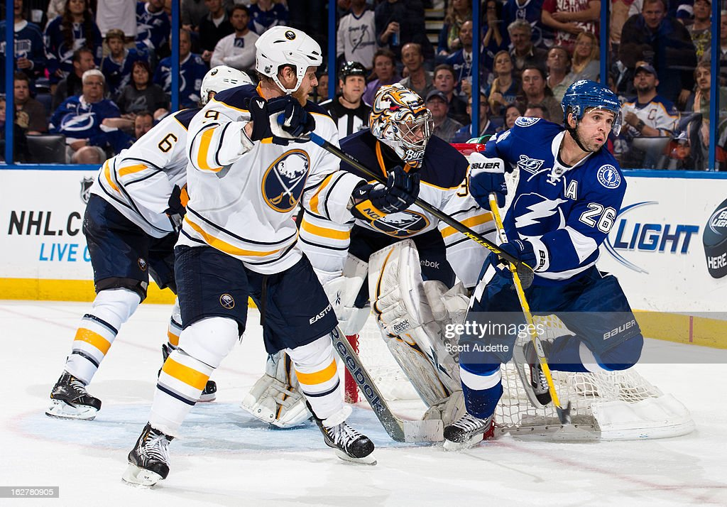 <a gi-track='captionPersonalityLinkClicked' href=/galleries/search?phrase=Steve+Ott&family=editorial&specificpeople=210616 ng-click='$event.stopPropagation()'>Steve Ott</a> #9 of the Buffalo Sabres tries to block <a gi-track='captionPersonalityLinkClicked' href=/galleries/search?phrase=Martin+St.+Louis&family=editorial&specificpeople=202067 ng-click='$event.stopPropagation()'>Martin St. Louis</a> #26 of the Tampa Bay Lightning during the third period of the game at the Tampa Bay Times Forum on February 26, 2013 in Tampa, Florida.