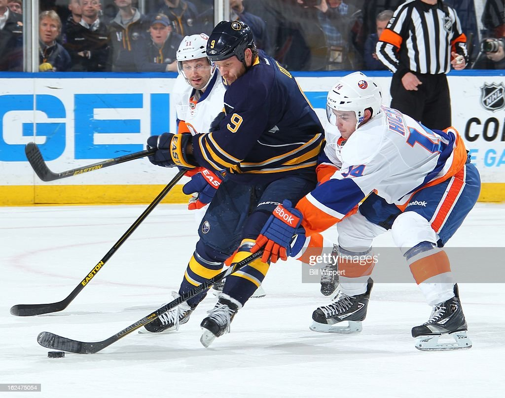 <a gi-track='captionPersonalityLinkClicked' href=/galleries/search?phrase=Steve+Ott&family=editorial&specificpeople=210616 ng-click='$event.stopPropagation()'>Steve Ott</a> #9 of the Buffalo Sabres tries to control the puck against Thomas Hickey #14 of the New York Islanders on February 23, 2013 at the First Niagara Center in Buffalo, New York.