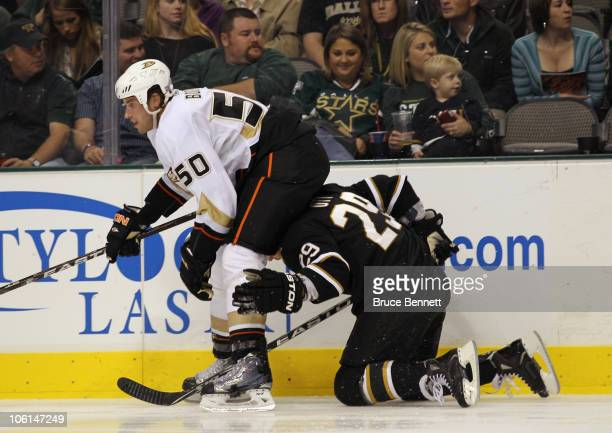 Steve Ott of the Dallas Stars is tripped up and falls into the back of Troy Brodie of the Anaheim Ducks at the American Airlines Center on October 26...