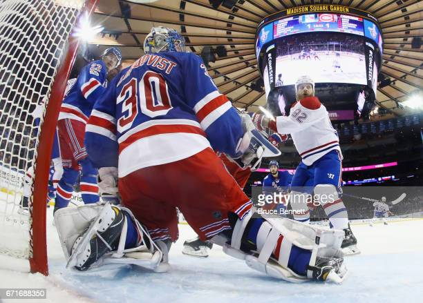 Steve Ott of the Montreal Canadiens skates against Henrik Lundqvist of the New York Rangers in Game Six of the Eastern Conference First Round during...