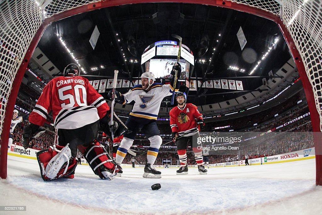 Steve Ott #9 of the St. Louis Blues and Brent Seabrook #7 of the Chicago Blackhawks watch the puck get past goalie Corey Crawford #50 in the first period of Game Four of the Western Conference First Round during the 2016 NHL Stanley Cup Playoffs at the United Center on April 19, 2016 in Chicago, Illinois.