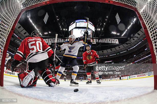 Steve Ott of the St Louis Blues and Brent Seabrook of the Chicago Blackhawks watch the puck get past goalie Corey Crawford in the first period of...
