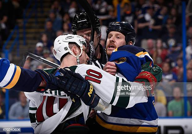 Steve Ott of the St Louis Blues gets physical with Jordan Schroeder of the Minnesota Wild in Game Two of the Western Conference Quarterfinals during...
