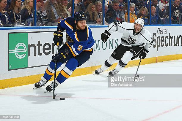 Steve Ott of the St Louis Blues handles the puck against Jamie McBain of the Los Angeles Kings on November 3 2015 at Scottrade Center in St Louis...