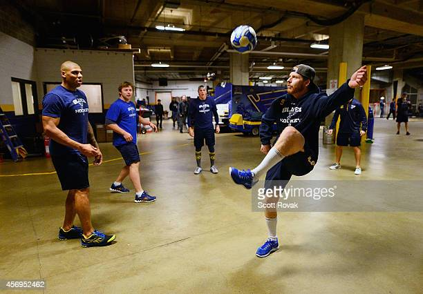 Steve Ott of the St Louis Blues juggles a soccer ball with teammates before a game against the New York Rangers on October 9 2014 at Scottrade Center...