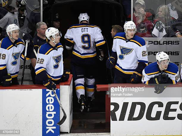 Steve Ott of the St Louis Blues leaves the game after a game misconduct penalty as teammate Jay Bouwmeester Kevin Shattenkirk Dmitrij Jaskin and...