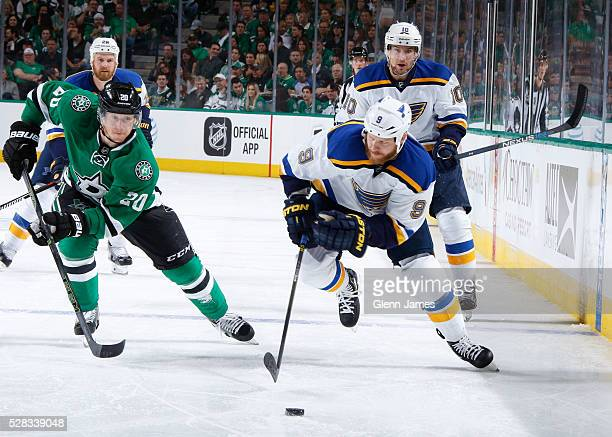 Steve Ott of the St Louis Blues tries to keep the puck away against Cody Eakin of the Dallas Stars in Game One of the Western Conference Second Round...