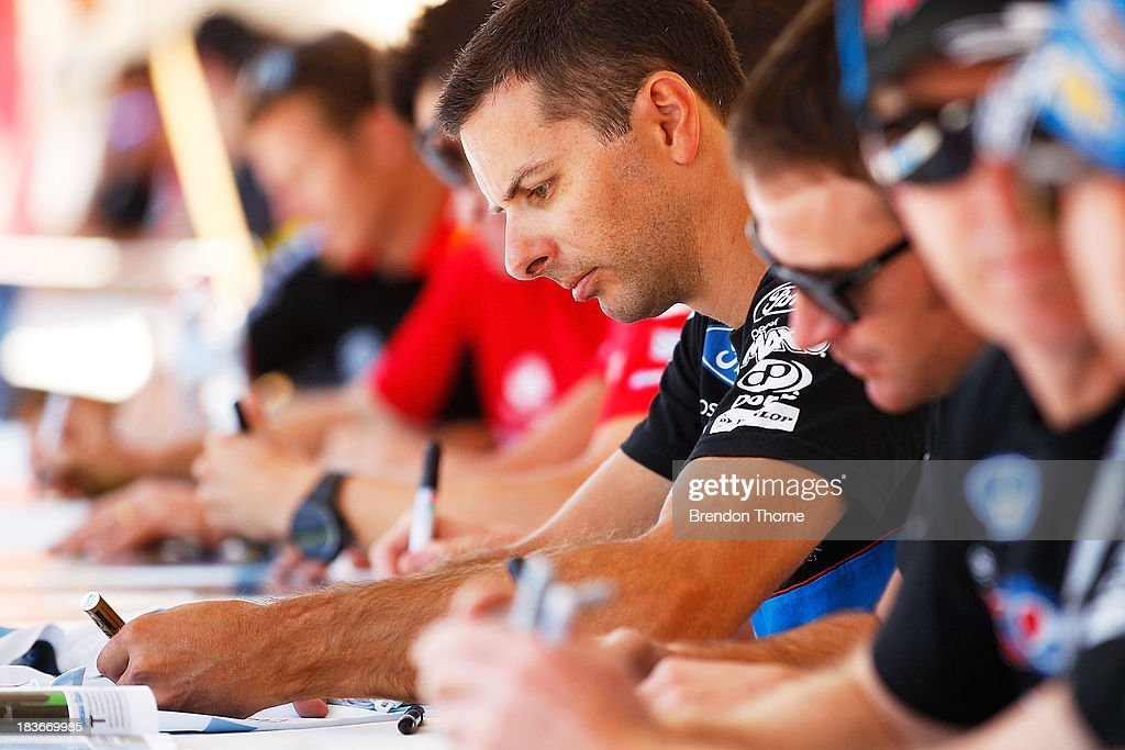 Steve Owen driver of the #6 Pepsi Max Crew FPR Ford signs autographs at an autograph session during previews ahead of the Bathurst 1000, which is round 11 of the V8 Supercars Championship Series on October 9, 2013 in Bathurst, Australia.