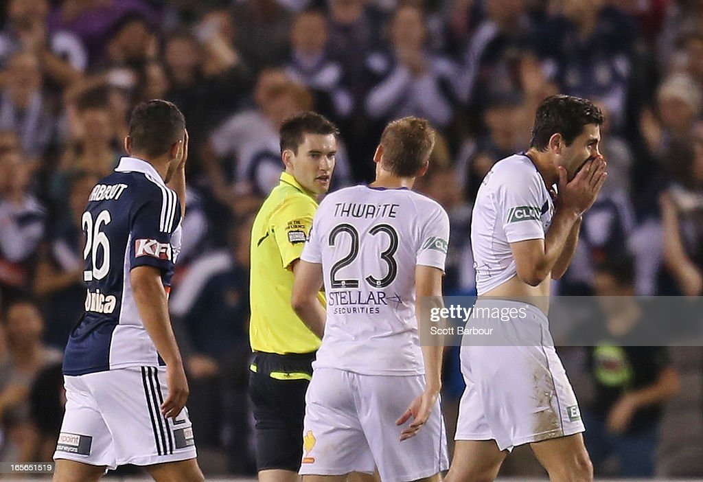 Steve Pantelidis (R) of the Glory is sent off by referee Jarred Gillett as Andrew Nabbout (L) of the Victory looks on during the A-League Elimination final match between the Melbourne Victory and Perth Glory at Etihad Stadium on April 5, 2013 in Melbourne, Australia.