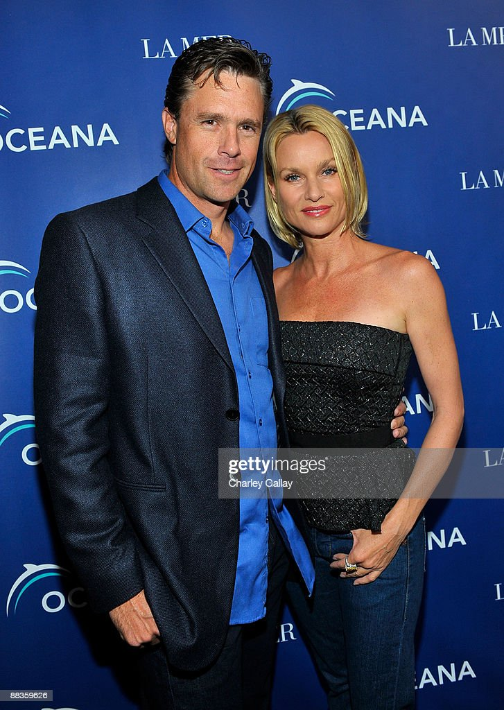 Steve Pate and actress Nicollette Sheridan attend Oceana's celebration of World Oceans Day with La Mer at Private Residence on June 8 2009 in Los...