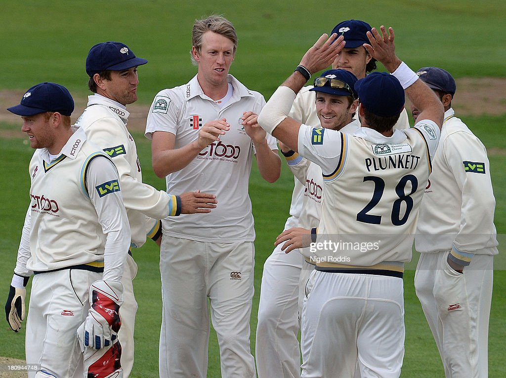 Steve Patterson (C) of Yorkshire celebrates with teamates after taking the wicket of Joe Denly Of Middlesex during day two of the LV County Championship Division One match between Yorkshire and Middlesex at Headingley Stadium on September 18, 2013 in Leeds, England.