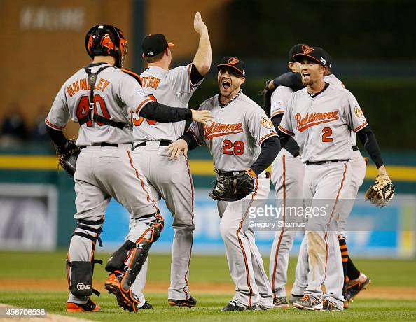 Steve Pearce and Nick Hundley of the Baltimore Orioles celebrate their 2 to 1 win over the Detroit Tigers to sweep the series in Game Three of the...