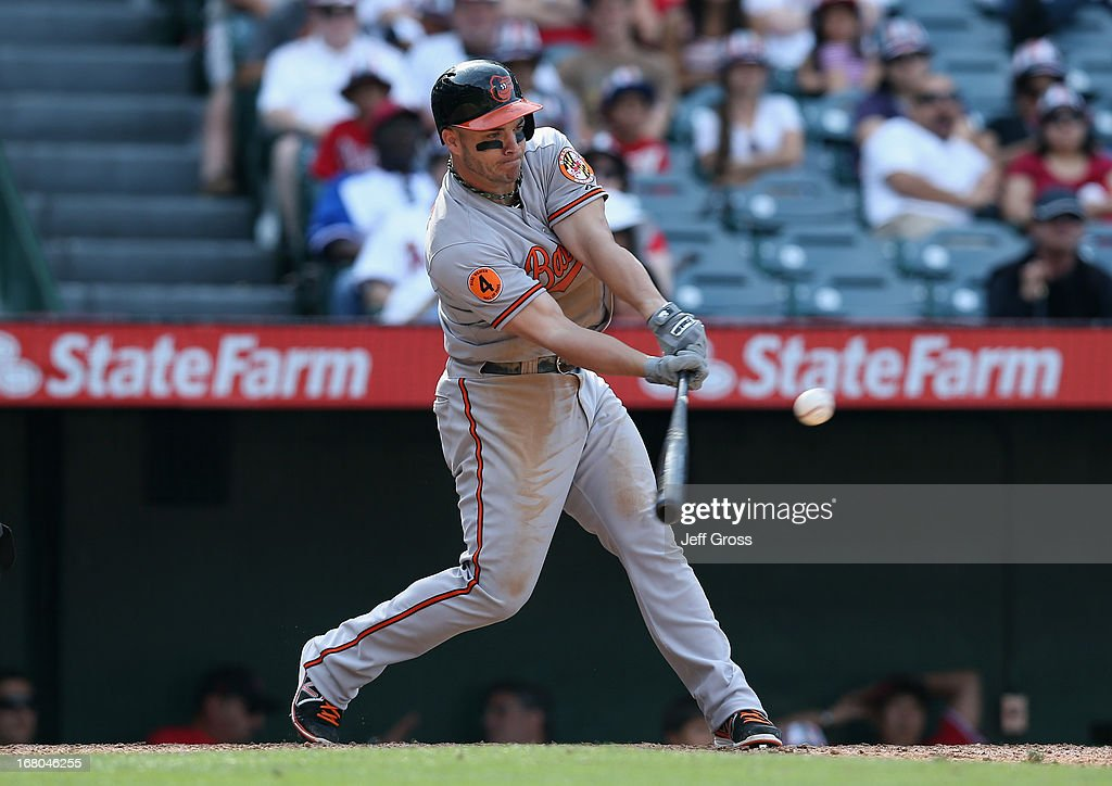 Steve Pearce #28 of the Baltimore Orioles drives in the go ahead run in the 10th inning at Angel Stadium of Anaheim on May 4, 2013 in Anaheim, California. The Orioles defeated the Angels 5-4 in ten innings.