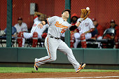 Steve Pearce of the Baltimore Orioles drops a fly ball in the ninth inning by Michael Taylor of the Washington Nationals at Nationals Park on...