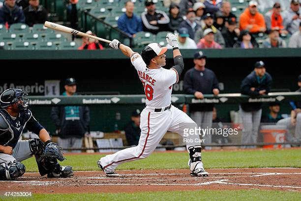 Steve Pearce of the Baltimore Orioles follows his grand slam against the Seattle Mariners in the first inning at Oriole Park at Camden Yards on May...