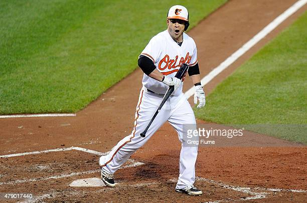 Steve Pearce of the Baltimore Orioles reacts after being called out on strikes to end the fourth inning against the Texas Rangers at Oriole Park at...