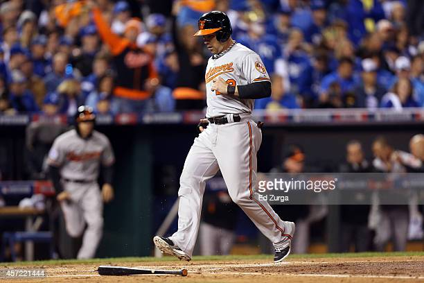 Steve Pearce of the Baltimore Orioles scores on JJ Hardy RBI double to right field in the second inning against Jeremy Guthrie of the Kansas City...