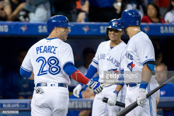 TORONTO ON AUGUST 16 Steve Pearce of the Blue Jays hit a solo home run and celebrated with his Ryan Goins and Kevin Pillar during the 4th inning of...
