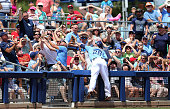 Steve Pearce of the Tampa Bay Rays reaches for the foul ball during the fourth inning of the Spring Training Game against the Boston Red Sox on March...