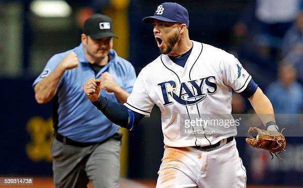 Steve Pearce of the Tampa Bay Rays reacts as umpire Dan Bellino signals the final out of the ninth inning of a game against the Houston Astros at...