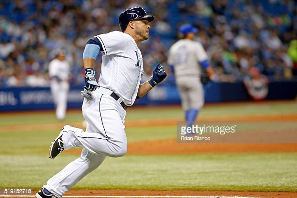 Steve Pearce of the Tampa Bay Rays runs toward first base after he flied out to center field during the seventh inning of a game against the Toronto...