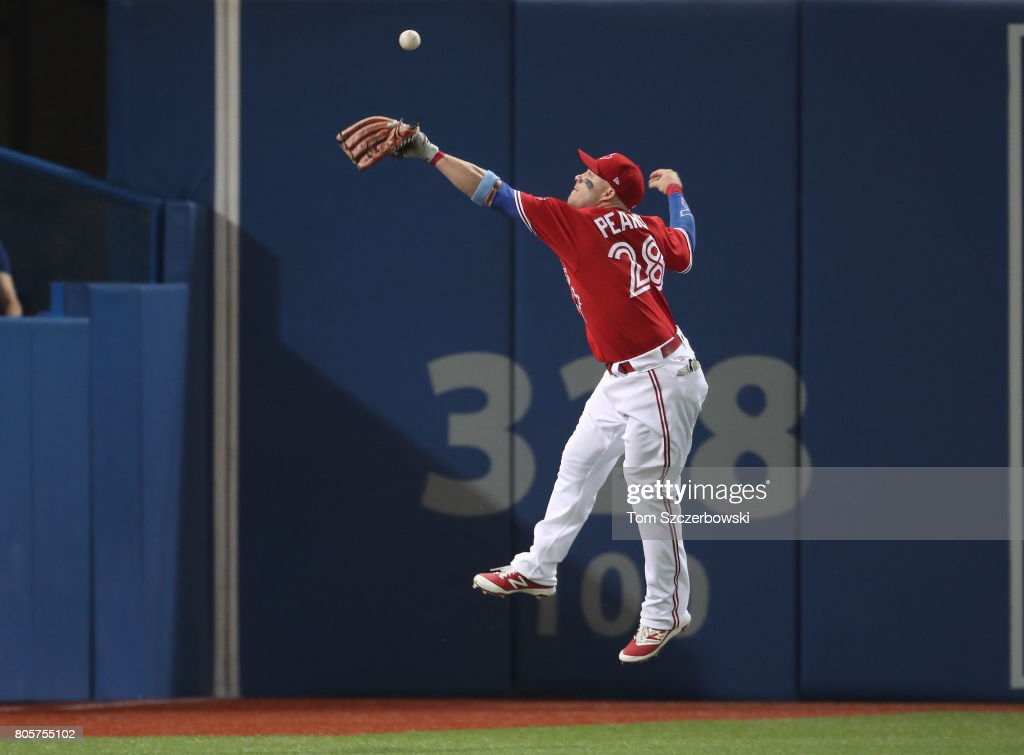 Steve Pearce #28 of the Toronto Blue Jays cannot get to a double by Andrew Benintendi #16 in the seventh inning during MLB game action against the Boston Red Sox at Rogers Centre on July 2, 2017 in Toronto, Canada.