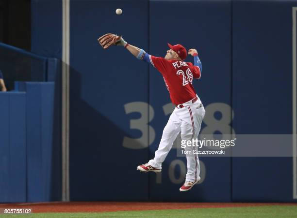 Steve Pearce of the Toronto Blue Jays cannot get to a double by Andrew Benintendi in the seventh inning during MLB game action against the Boston Red...