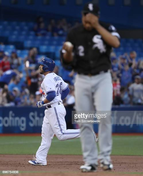 Steve Pearce of the Toronto Blue Jays circles the bases after hitting a solo home run in the third inning during MLB game action as Jose Quintana of...