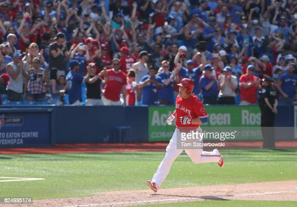 Steve Pearce of the Toronto Blue Jays circles the bases after hitting a gamewinning grand slam home run in the ninth inning during MLB game action...