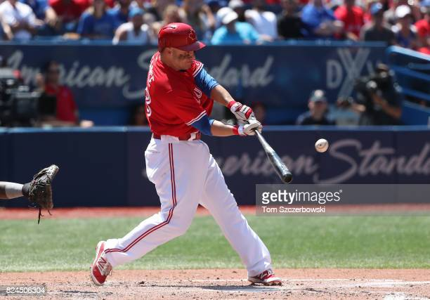 Steve Pearce of the Toronto Blue Jays hits a double in the third inning during MLB game action against the Los Angeles Angels of Anaheim at Rogers...