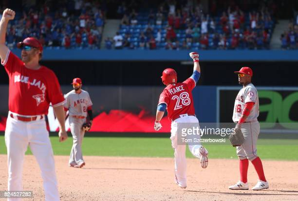 Steve Pearce of the Toronto Blue Jays is celebrates as he hits a gamewinning grand slam home run in the ninth inning during MLB game action against...