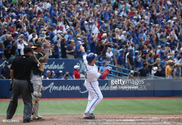 Steve Pearce of the Toronto Blue Jays reacts as he hits a gamewinning grand slam home run in the tenth inning during MLB game action against the...