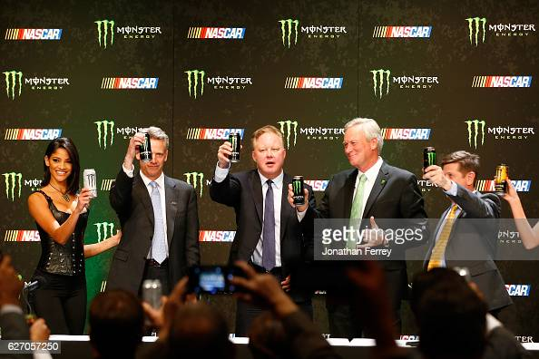 Steve Phelps Brian France Mark Hall and Mitch Covington toast during a press conference as NASCAR and Monster Energy announce premier series...
