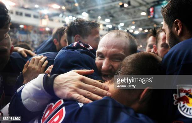 Steve Pinizzotto of Muenchen and his team mates celebrate winning the DEL PlayOffs Final Match 5 between EHC Muenchen and the Grizzlys Wolfsburg at...
