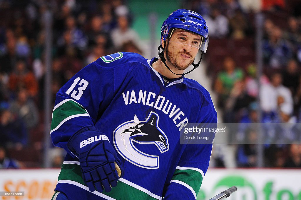 <a gi-track='captionPersonalityLinkClicked' href=/galleries/search?phrase=Steve+Pinizzotto&family=editorial&specificpeople=4671550 ng-click='$event.stopPropagation()'>Steve Pinizzotto</a> #13 of the Vancouver Canucks smiles between play during the game against the Nashville Predators at Rogers Arena on March 14, 2013 in Vancouver, British Columbia, Canada. The Vancouver Canucks won 7-4.