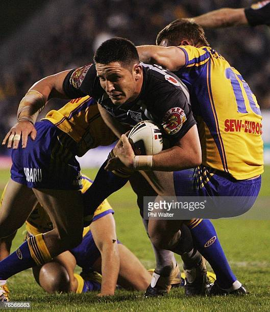 Steve Price of the Warriors is held back by Chad Robinson of the Paramatta Eels during the NRL qualifying final match between the Warriors and the...