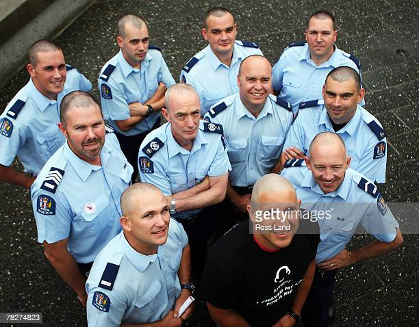 Steve Price of the Warriors poses with members of the Avondale Police Force after having their heads shaved in support of the Funrazor Fight Against...
