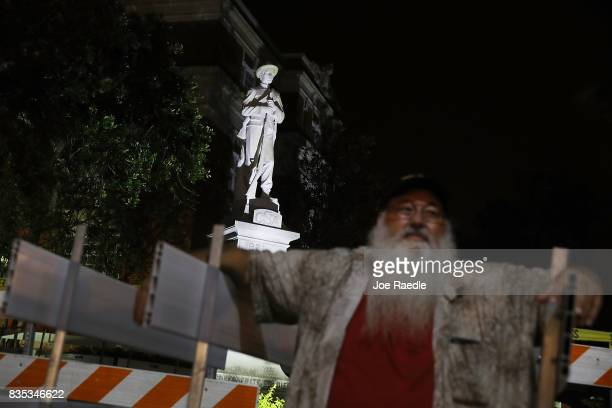 Steve Prindle keeps an eye out for possible protesters in front of a Confederate monument at the Hernando County Courthouse in the midst of a...