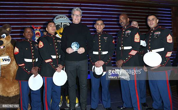 Steve Radenbaugh pose with US Marines during eZWayCares Community Santa Toy Drive on December 18 2016 in Los Angeles California