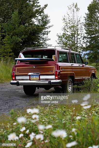 Steve Rader packs up his board after a day spent surfing the Bore Tide at Turnagain Arm on July 13 2014 in Anchorage Alaska Alaska's most famous Bore...