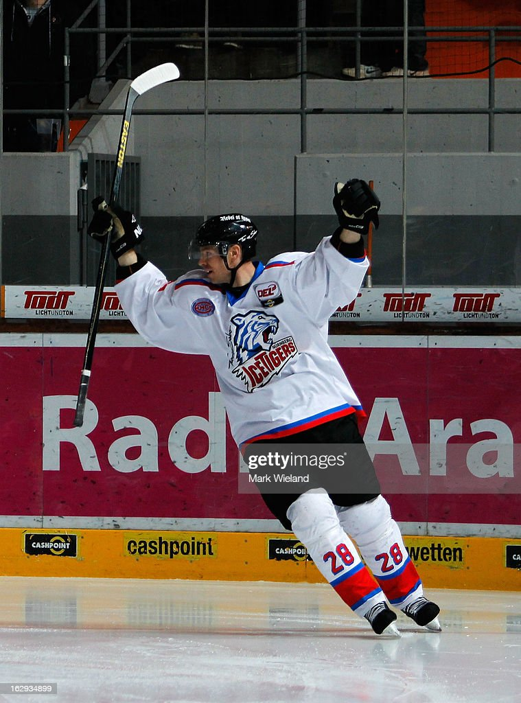 Steve Reinprecht of Thomas Sabo Ice Tigers celebrates scoring during the DEL match between EHC Red Bull Muenchen and Thomas Sabo Ice Tigers at Olympia Eishalle on March 1, 2013 in Munich, Germany.