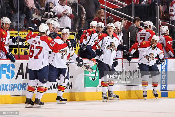 Steve Reinprecht Shawn Matthias and Kenndal McArdle of the Florida Panthers celebrate with Michael Frolik after Frolik scored the game winning shoot...
