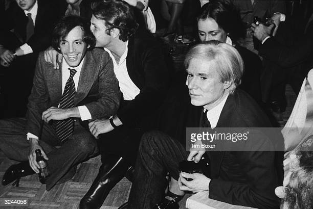 Steve Rubell coowner of the nightclub Studio 54 and artist Andy Warhol watch the Academy Awards during an Oscars party at Studio 54 New York City