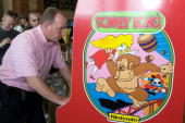 Steve Sanders 'The Orignal King of Kong' plays Donkey Kong at the launch party for the International Video Game Hall of Fame and Museum on August 13...