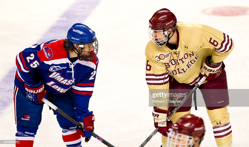 Steve Santini of the Boston College Eagles and Dylan Zink of the Massachusetts Lowell River Hawks exchange words during the NCAA Division I Men's Ice...