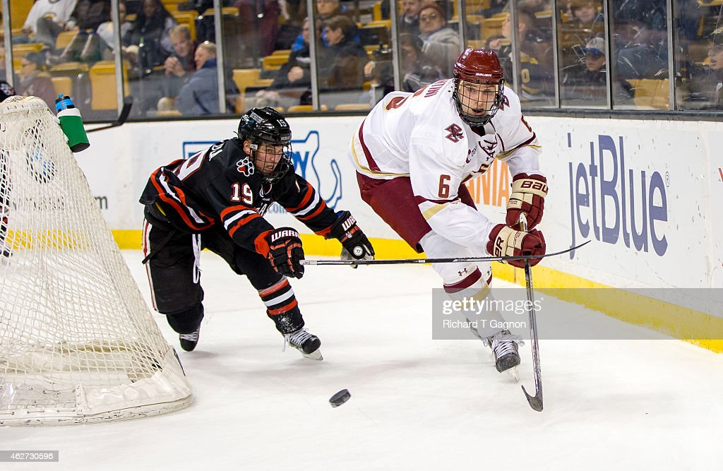 Steve Santini of the Boston College Eagles skates away from Mike Szmatula of the Northeastern Huskies during NCAA hockey in the semifinals of the...