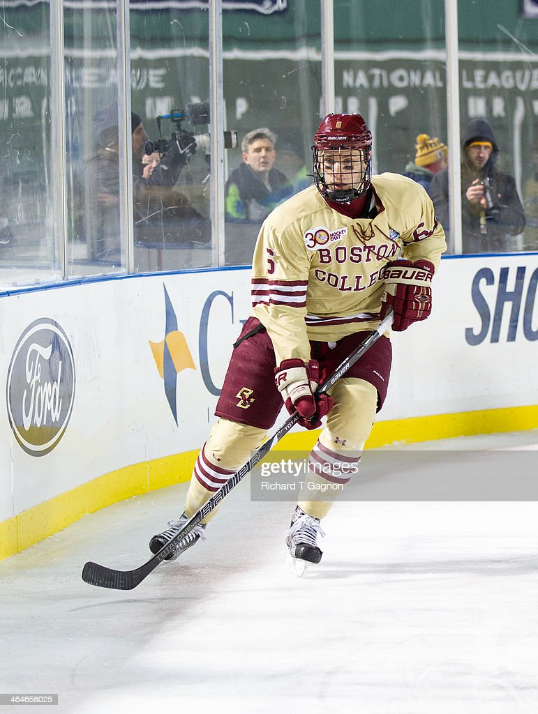 Steve Santini of the Boston College Eagles skates behind the net against the Notre Dame Fighting Irish during NCAA hockey action in the 'Citi Frozen...