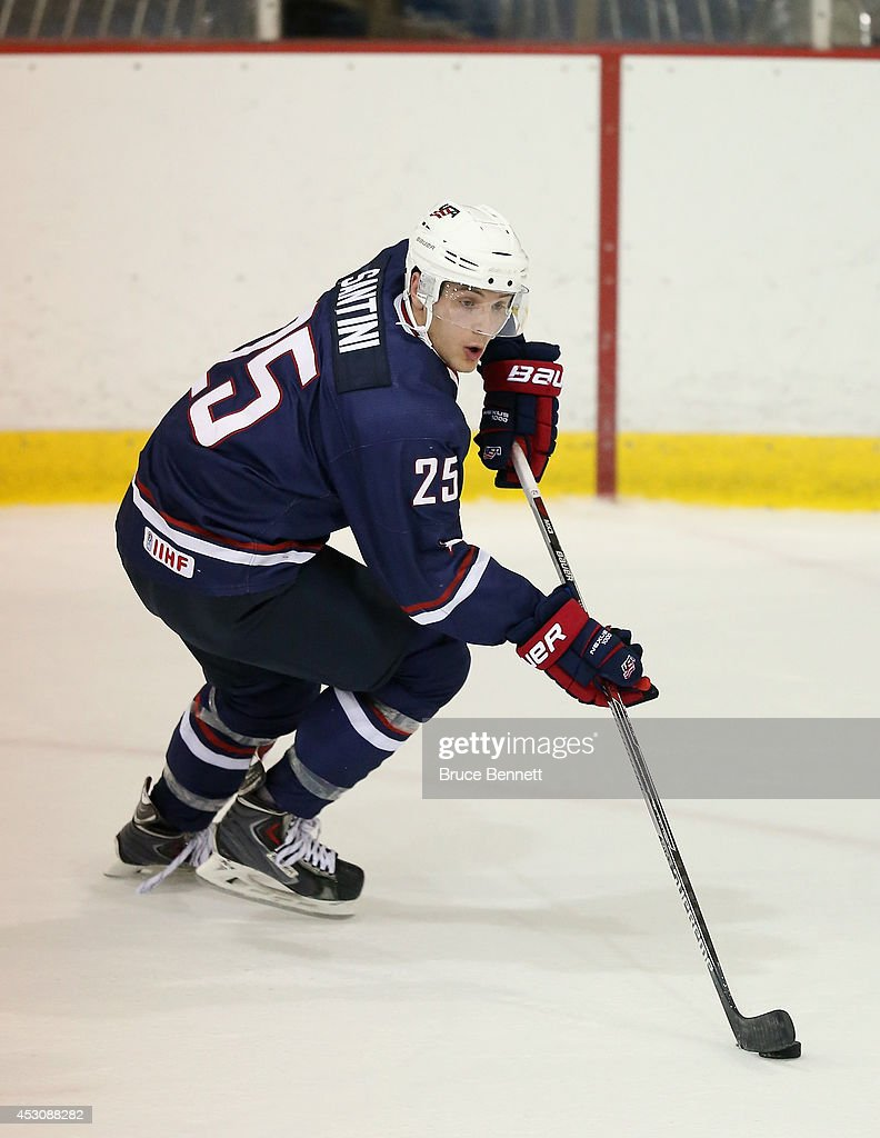 Steve Santini of USA Blue skates against USA White during the 2014 USA Hockey Junior Evaluation Camp at Lake Placid Olympic Center on August 2 2014...